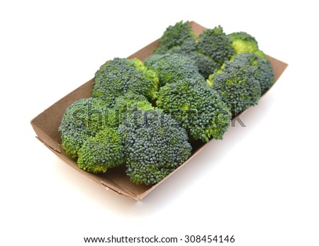 Fresh broccoli in tray on white background  - stock photo
