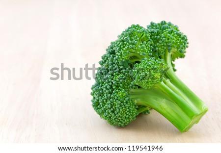 Fresh broccoli on desk - stock photo