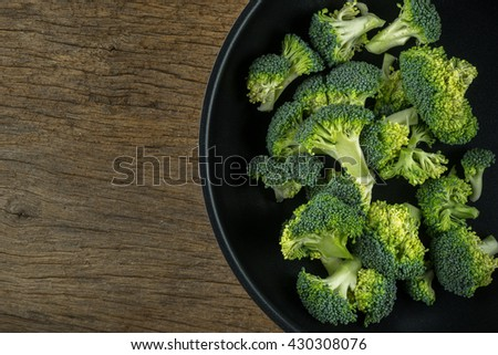 Fresh broccoli on frying pan vegetarian cooking.Broccoli is green plant.Broccoli is rich nutrition vitamin.Broccoli can provide special cholesterol-lowering diet.Broccoli is Antioxidant vegetable. - stock photo