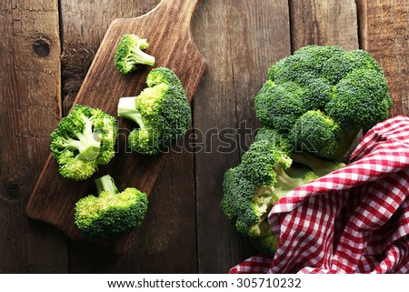 Fresh broccoli on wooden table close up - stock photo