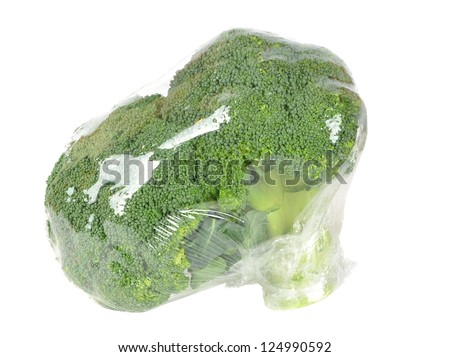 Fresh broccoli pre packed in plastic foil wrapping - stock photo