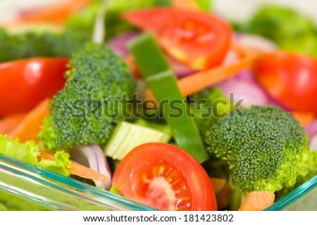Fresh broccoli salad with lettuce, broccoli and tomato - stock photo