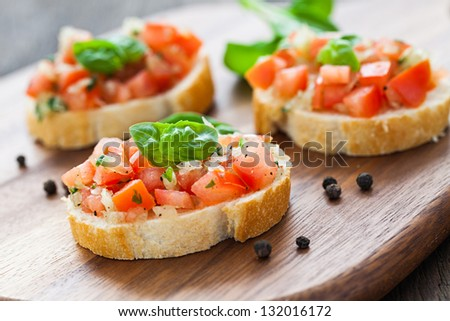 fresh bruschetta on cutting board - stock photo