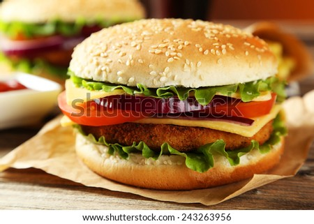 Fresh burger on brown wooden background