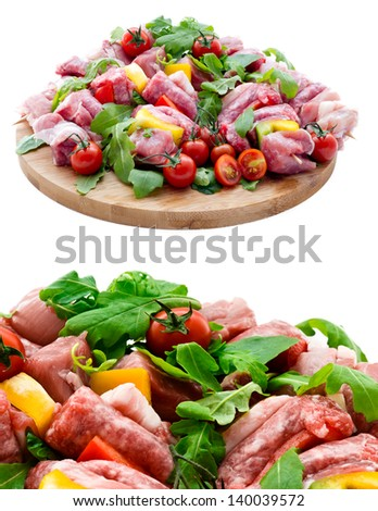Fresh butcher cut meat assortment garnished  isolated on white background - stock photo