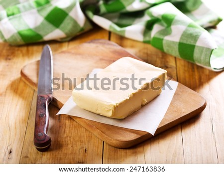 fresh butter on wooden board