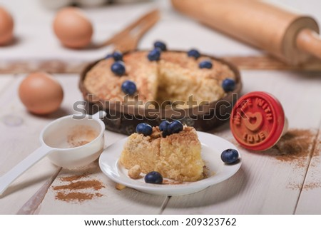 Fresh cake with blueberries on wood table   - stock photo
