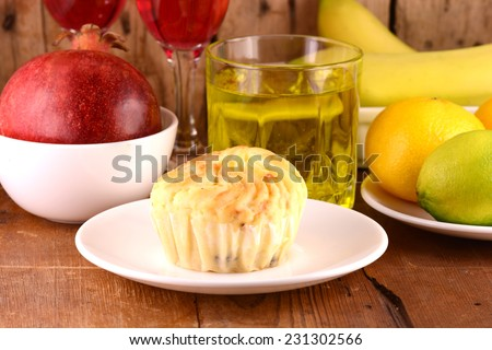 fresh cake with fruits and wine, sweet cake with grapefruits and bananas - stock photo