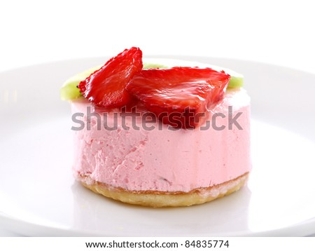 Fresh cake with strawberry and kiwi on the plate - stock photo