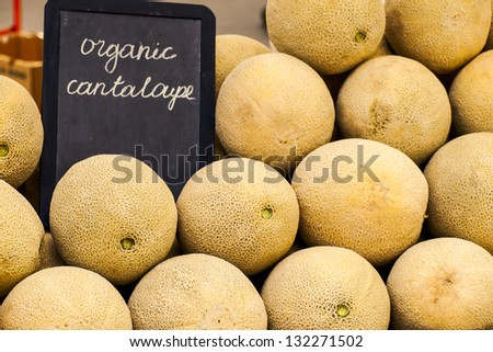 Fresh cantaloupe at the local farmers market. Farmers markets are a traditional way of selling agricultural products. - stock photo