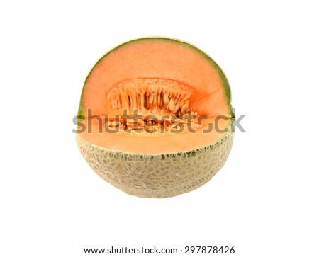 Fresh cantaloupe melon cut open to show orange flesh and many sticky seeds - stock photo