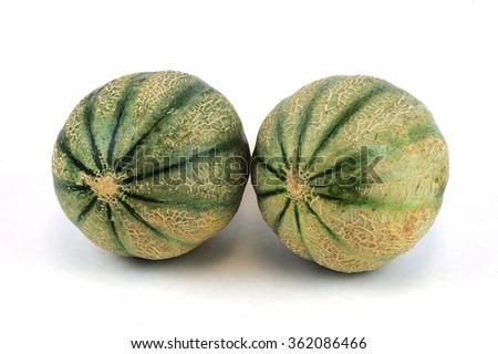 fresh cantaloupe melons on white background - stock photo
