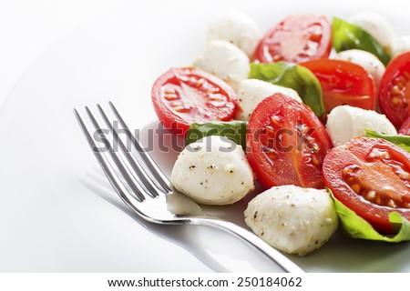 Fresh caprese salad on white background close up - stock photo