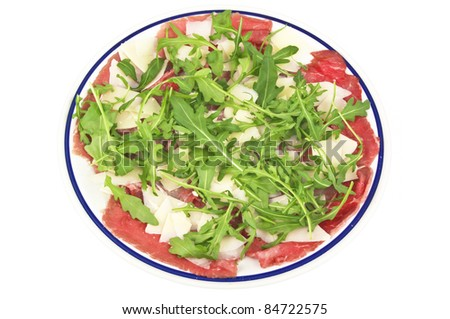 fresh carpaccio on the plate - stock photo