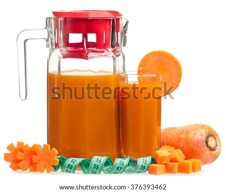 Fresh carrot juice in the glass with tape measure isolated on white background - stock photo