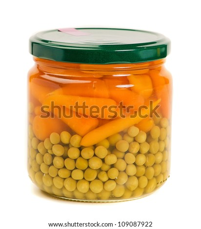 fresh carrots and green peas in a glass jar isolated on a white background - stock photo