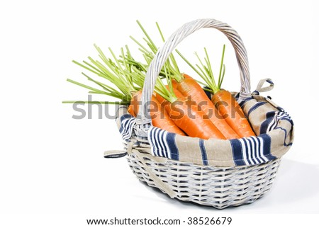 Fresh carrots  in a basket against a white background - stock photo