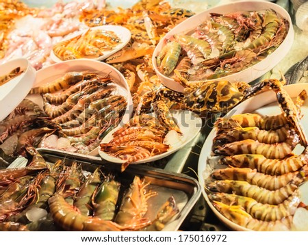 fresh-caught seafood, different types of shrimps - stock photo
