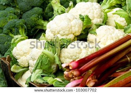 Fresh cauliflowers on the market stand - stock photo