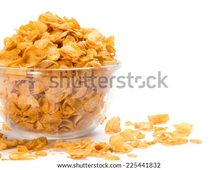 fresh cereal cornflakes in a bowl isolated on white background - stock photo