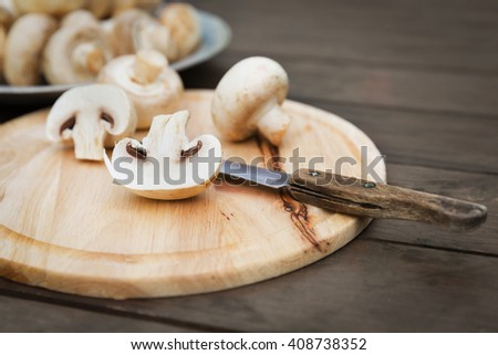 Fresh champignon mushhrooms - stock photo