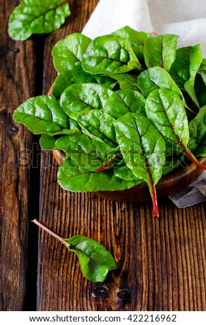 Fresh chard leaves in a wooden bowl - stock photo