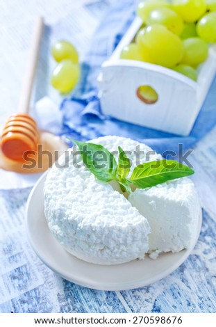 fresh cheese and knife on the wooden board - stock photo