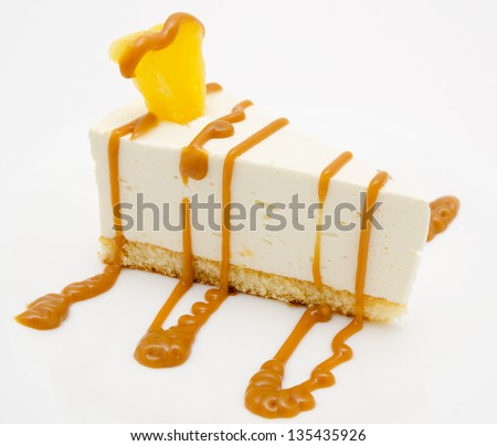 fresh cheese cake with caramel syrup and piece of pineapple - stock photo