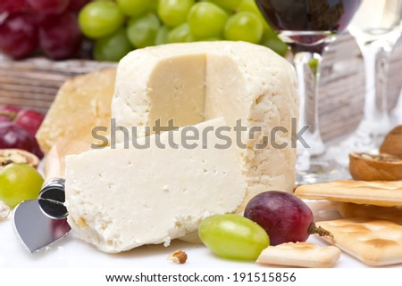 fresh cheese, crackers and grapes, close-up, horizontal