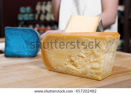 Fresh cheese on the table in cellar - stock photo