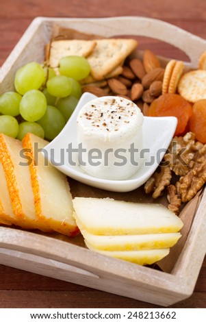 fresh cheese with pepper, toasts and grapes - stock photo