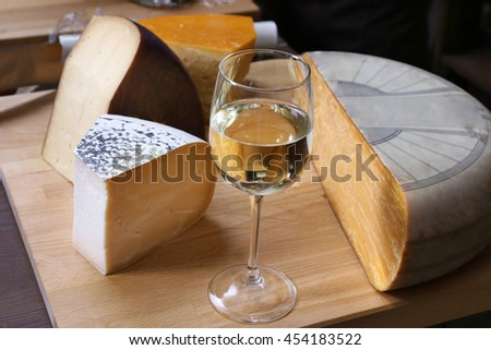 Fresh cheese with wine on the table in cellar - stock photo