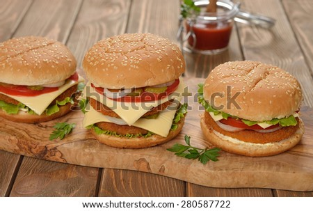 Fresh cheeseburger on a brown background - stock photo