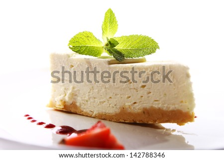 Fresh cheesecake served with mint and berry sauce - stock photo