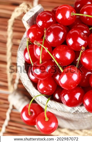 Fresh cherries in a wood bucket  - stock photo