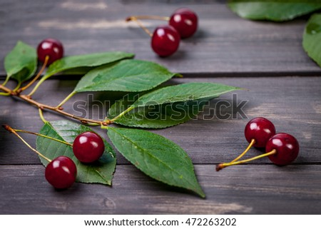 Fresh cherries in bowl on table. Cherry background. Cherry on dark wooden background.