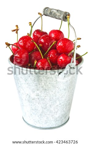 Fresh cherries in metal bucket isolated on white background - stock photo