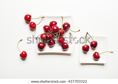 Fresh cherries on a white background close up. - stock photo