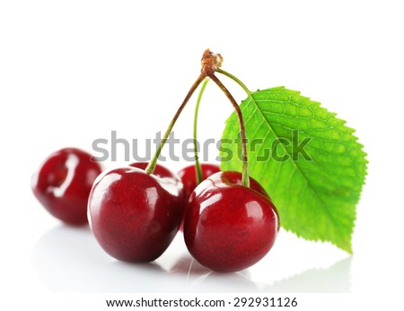 Fresh cherries with leaf isolated on white