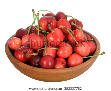 fresh cherry fruits in bowl isolated in white background