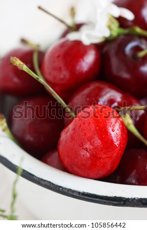 Fresh cherry on a white plate with flowers