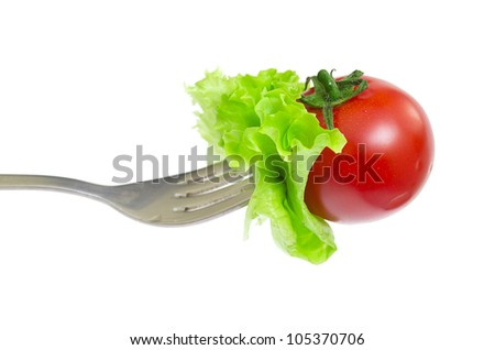 Fresh cherry tomato on fork isolated at white background - stock photo