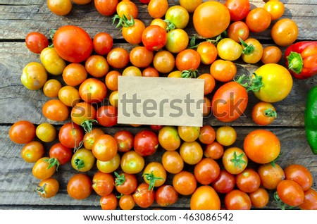 Fresh cherry tomatoes on a wooden table in various compositions, mock up