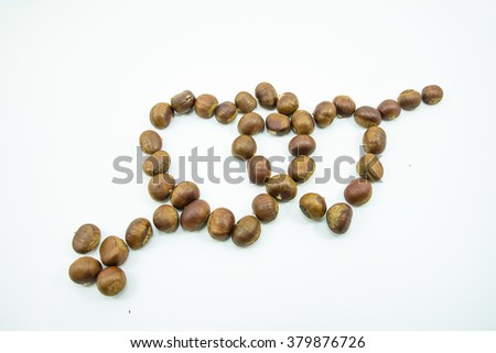 Fresh chestnuts close-up isolated,in the shape of heart  on white background.