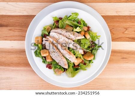 Fresh chicken caesar salad - stock photo