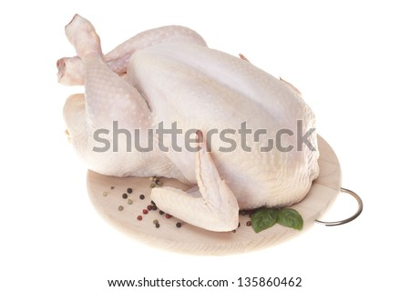 Fresh chicken on wooden board with spices - stock photo