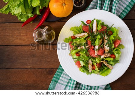 Fresh chicken salad, grapefruit, lettuce and honey mustard dressing. Dietary menu. Proper nutrition. Top view - stock photo