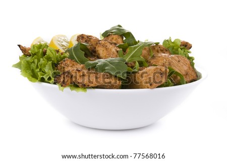Fresh chicken salad isolated on white background - stock photo