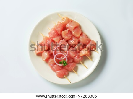 Fresh chicken skewers  - stock photo