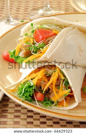 Fresh chicken wraps with cheddar cheese
